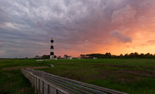 Bodie Island Lighthouse, North Carolina, sunset, OBX, Outer Banks, Hatteras Island, Cape Hatteras Seashores, scenic, marsh, dramatic sky, serene, outdoor, landscape, historic, atlantic, ocean